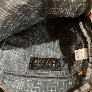Black side sling